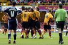 Luke Medley is mobbed by his City team-mates after a sensational goal with his first touch
