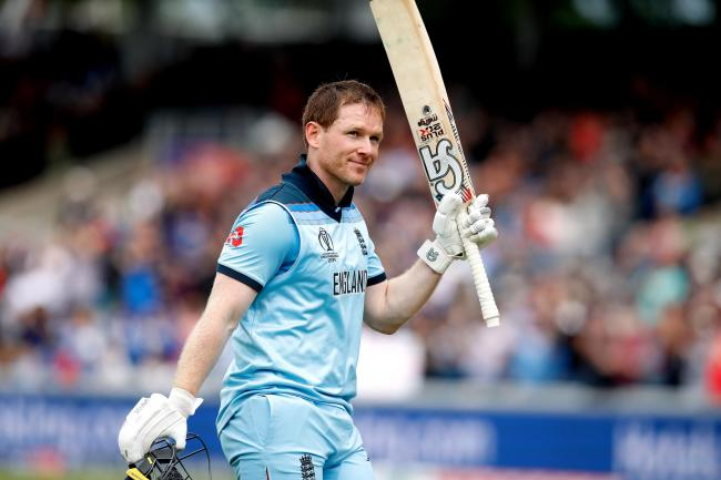 Eoin Morgan salutes the Old Trafford crowd after his 148