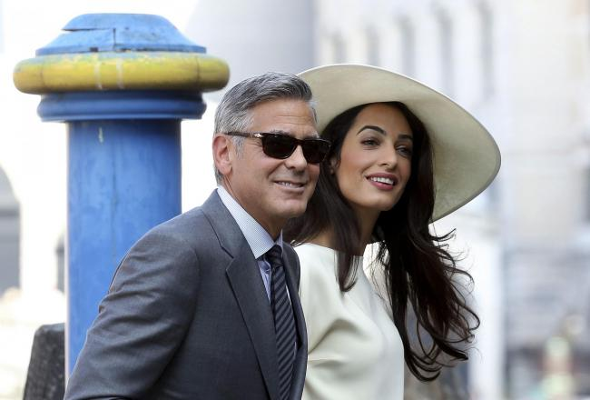 Golden couple George and Amal Clooney. Picture: Reuters/Alessandro Bianchi