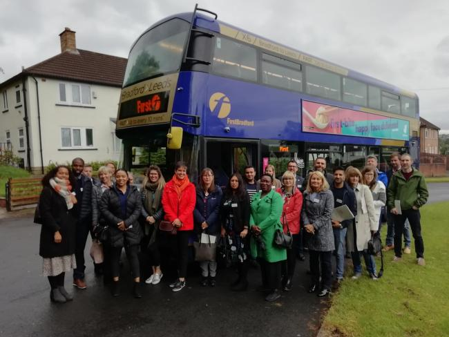 Bradford businesspeople on their bus tour of meeting charities supported by GiveBradford