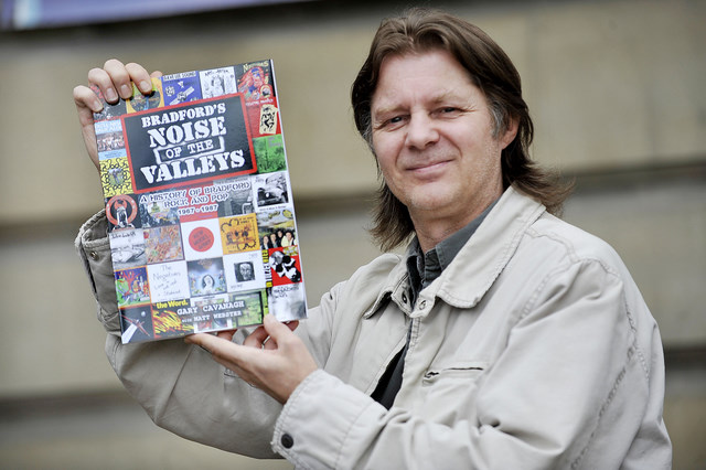 Gary Cavanagh with his book which chronicles pop and rock in Bradford from the late 1960s to the late 1980s