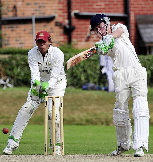Baildon skipper Jonny Reynolds, pictured here batting, says his side remain focused on promotion to the All Rounder Cricket Bradford Premier League Premier Division