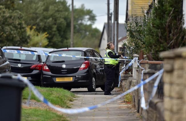 Police at the scene in Sandford Road, Bradford Moor, where Amriz Iqbal was murdered by Mohammed Nisar Khan, known as Meggy, and Tony Grant, on October 3 last year. West Yorkshire Police's major crime unit has seen officer numbers drop by 47% since 2010