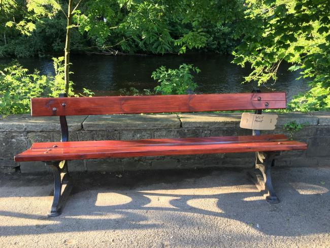One of the repaired benches in Ilkley's Riverside Park