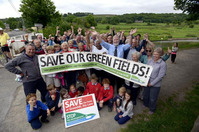 The Greenhill action group are picured on Sty Lane, Miclethwaite, celebrating the fact that the land behind them in the picture is not going to be built on. AG rep newsdesk