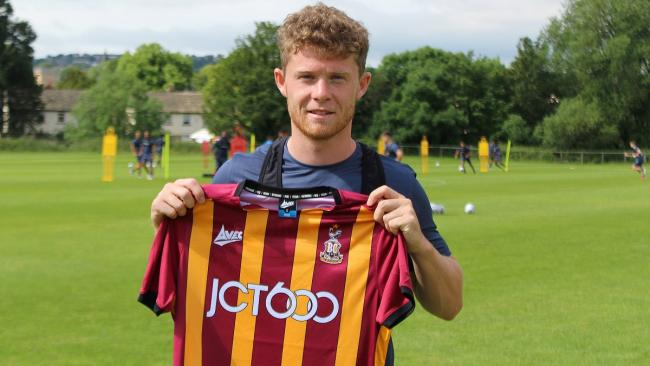 Matty Palmer shows off his City shirt after signing on loan