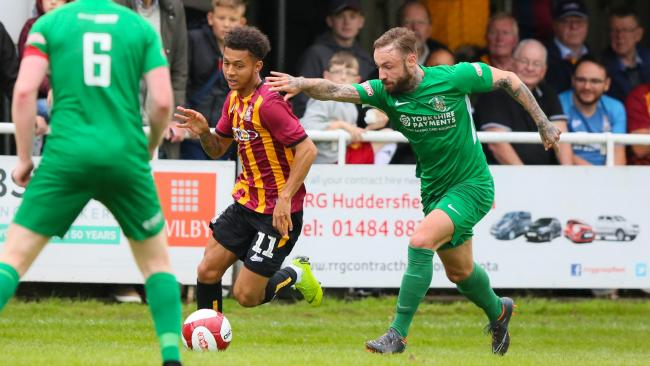 Brighouse Town in action against Bradford City before the start of last season Picture: Tom Gadd