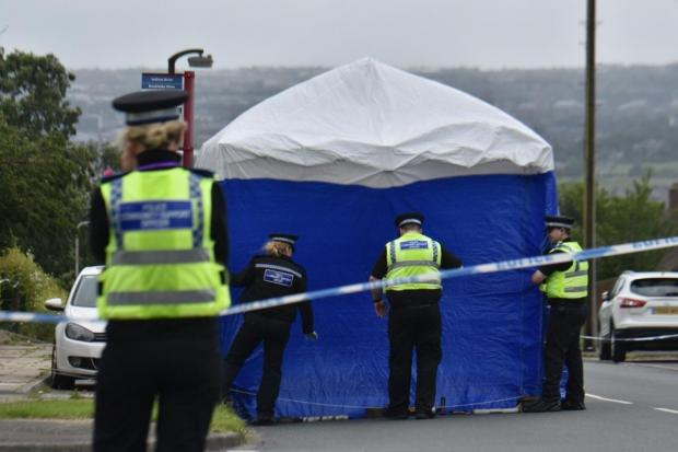 Bradford Telegraph and Argus: Police at the scene on Saffron Drive