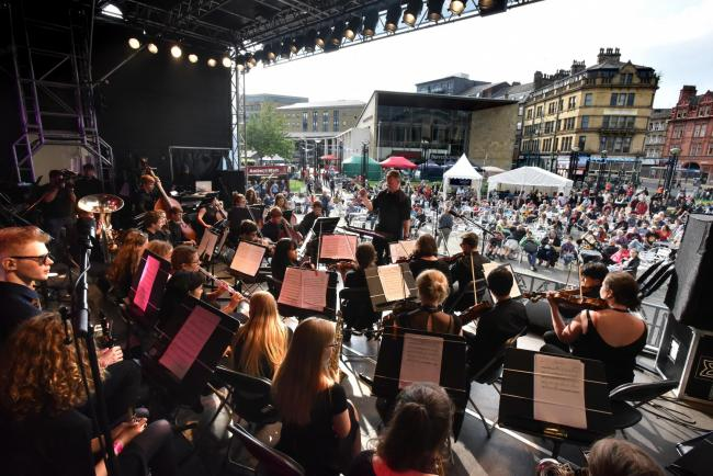 Normanton Street Bradford Youth Orchestra play to a large crowd at Bradford Festival