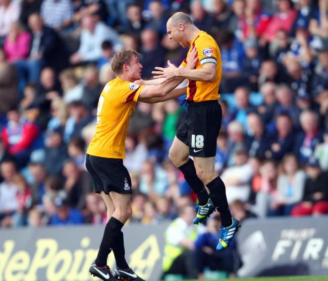 Stephen Darby and Gary Jones celebrate the former City skipper scoring against Gillingham. The pair have remained close friends