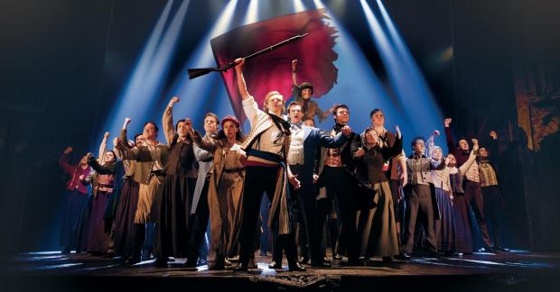 Bradford Telegraph and Argus: Danny in grey coat, left of centre, in Les Miserables. Picture: Matthew Murphy