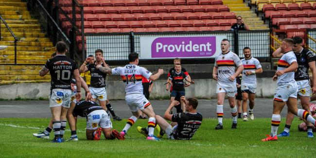 Action from Bulls' 34-34 draw against Swinton Lions. Picture: Tom Pearson