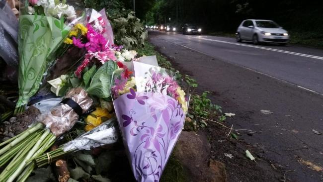 Flowers left by the side of the A660 at Old Pool Bank in June, 2017 for Kate Whalley