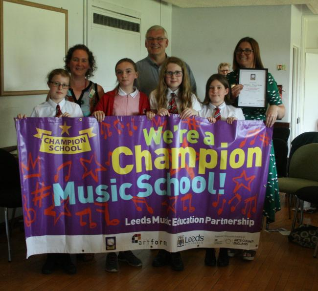 Staff and pupils from Westgate Primary School receiving their Music Champion award