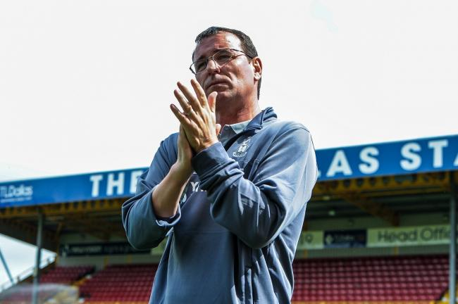 Gary Bowyer claps the fans before Saturday's friendly against Wigan. Pic: Tom Pearson