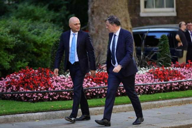 Julian Smith, right, and Sajid Javid arriving for the first Cabinet meeting of new PM Boris Johnson
