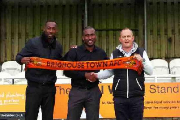 Brighouse Town manager Vill Powell, centre, saw his side grab a league win over Colne