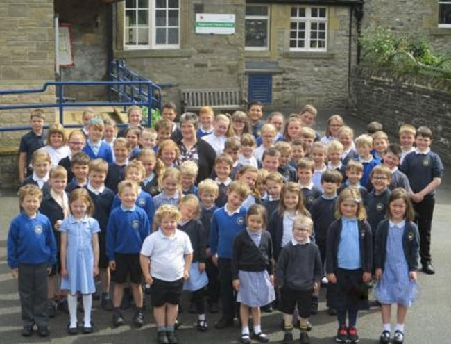 Anne Michelmore-Brown with pupils at Giggleswick Primary School
