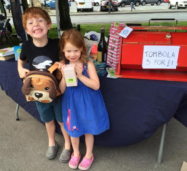 George and Emma Bird with their tombola prizes at the Ilkley-Coutances Twinning Committee stall