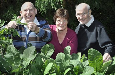 Enjoying a bumper crop are, from left, Donald Summerscales, Josie Stocking and resident Danny Rodd