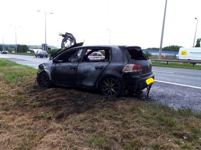 The burned-out VW Golf
