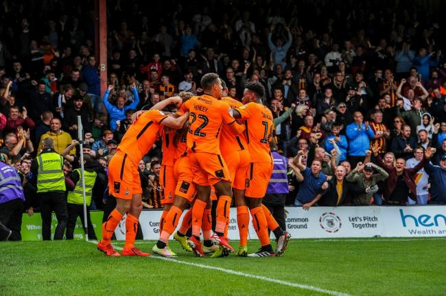 City celebrate James Vaughan's goal in front of the away fans at Grimsby Town. Picture: Tom Pearson