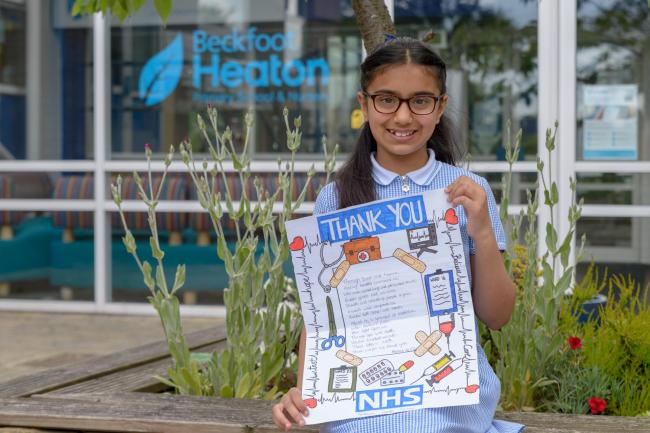 Beckfoot Heaton pupil Hafsah Ali, ten, with her award-winning design celebrating the NHS and its staff