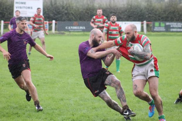 Nomads player Lee Shaw attempts to bring down a Keighley ball carrier in atrocious conditions at the Skiptens tournament. Picture: Georgie Elizabeth Green