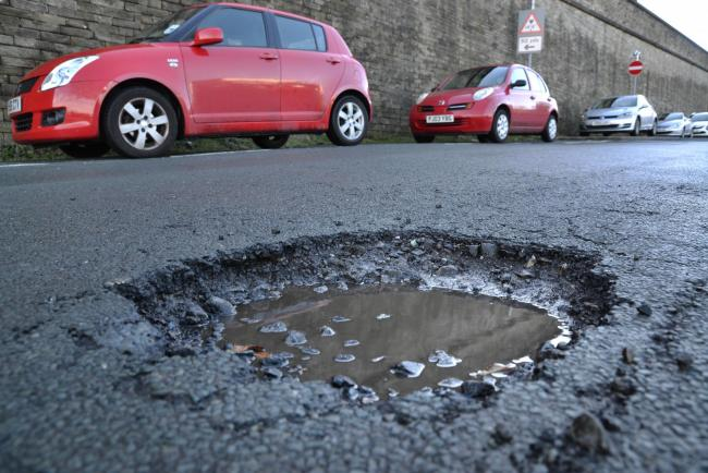 A pothole on Hatcliffe Lane in Bradford earlier this year