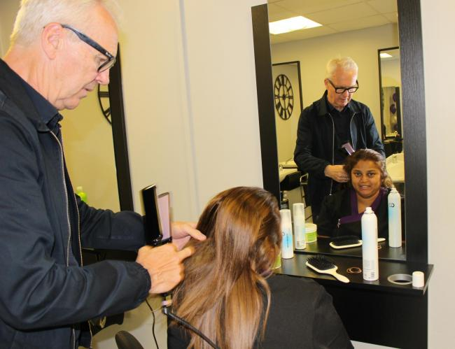 Andrew Collinge straightens Geeta's hair at Mirror Mirror