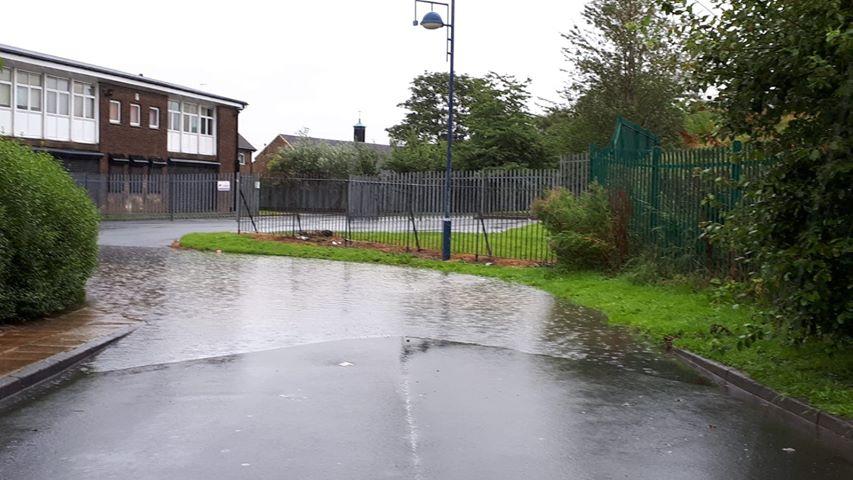 Sewage floods street in Dulverton Grove, Holme Wood