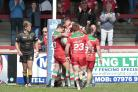 The Keighley Cougars squad celebrate Jack Miller's try in their heavy loss to Whitehaven in Betfred League One at Cougar Park. Picture: Charlie Perry