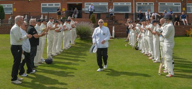 Umpire Alan Carter was given a guard of honour at last Sunday's Jack Hampshire Cup final. Picture: Ray Spencer