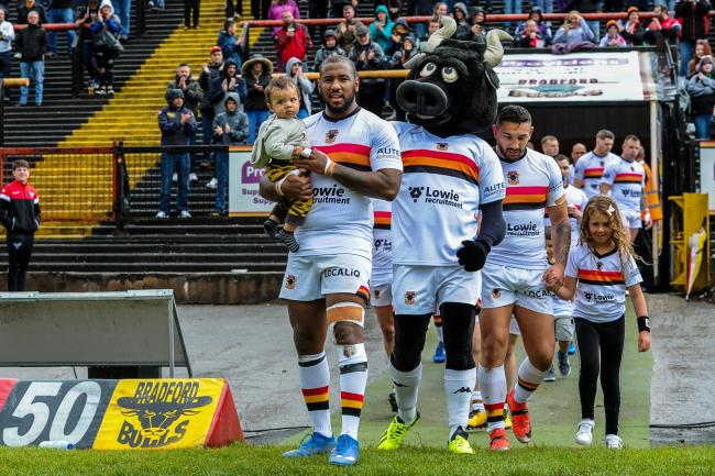 Ross Peltier leads the Bulls out against Batley with his son on his 100th career appearance  Picture: Tom Pearson