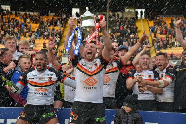 The Bradford Bulls squad celebrate after securing promotion to the Betfred Championship after beating Workington Town 27-8 in the play-off final at Odsal. Picture: Richard Leach