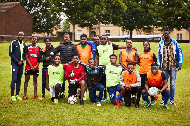 Members of the Connecting Opportunities football team, who have all been helped into work or further education by the programme