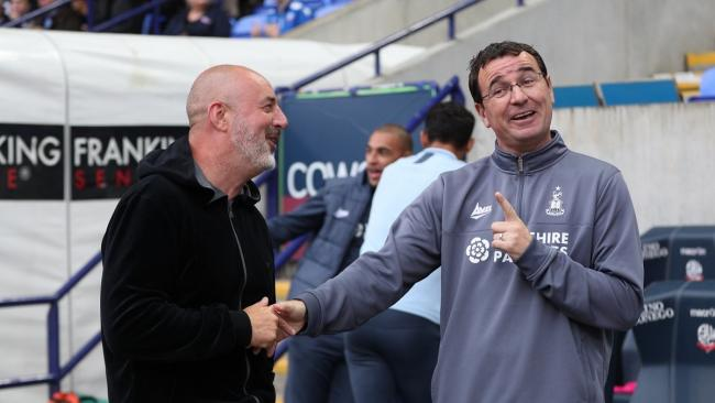 Gary Bowyer shares a joke with new Bolton boss Keith Hill before tonight's game. Pic: Thomas Gadd