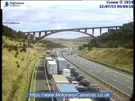 Woman dies and man arrested after M62 crash between junction