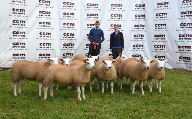 Owain Chapman and Jenny Dolphin with their first prize Texel gimmer lambs. Picture Robin Moule