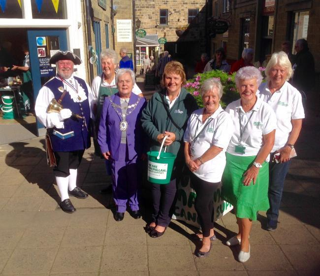 The fundraising group with former Otley Mayor Mary Vickers and Bellman Terry Ford at last year's World Biggest Coffee Morning
