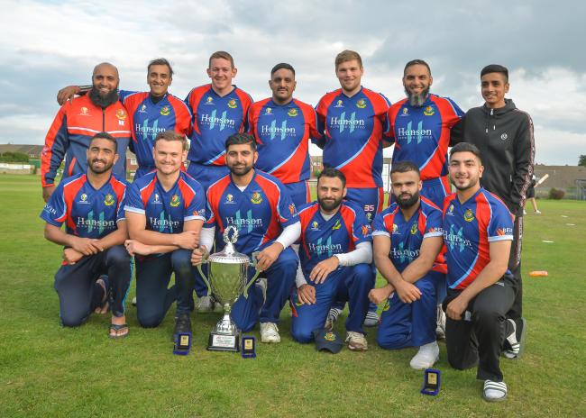 Jer Lane with their T20 trophy from last season Picture: Ray Spencer
