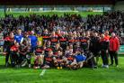 The Bulls pose for a team photo after the final game of the season at Rochdale on Sunday; below, vice-captain Elliot Minchella celebrates after beating Leeds in the Challenge Cup. Pictures: Tom Pearson