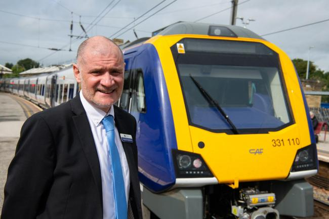 Steve Hopkinson, Northern regional director, with one of the new trains