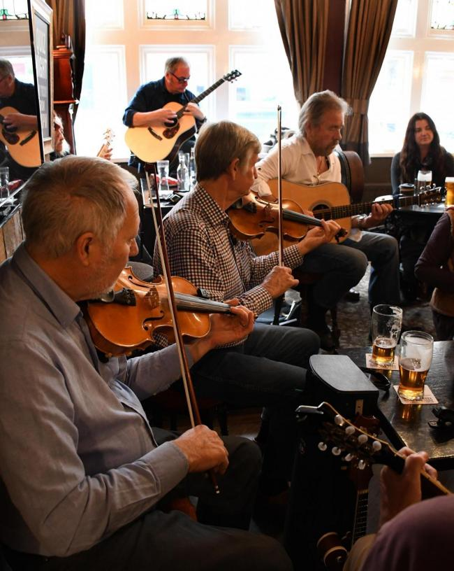 Acoustic musicians jamming at the White Swan during the 2018 Otley Folk Festival