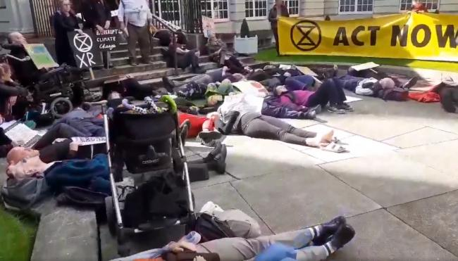 Campaigners staging a 'die-in' in protest at airport expansion plans