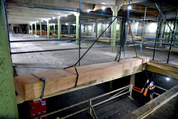Bradford Telegraph and Argus: New floor joists being lifted into place to replace the rotten floors