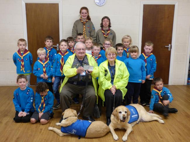 1st Bingley beavers present cheque to Guide Dogs Bradford branch