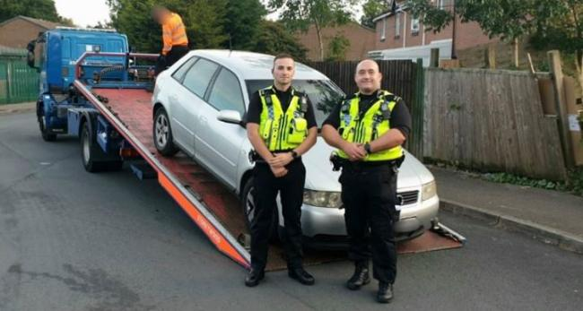 Special Constables Irvin and Moore with the seized Audi A4