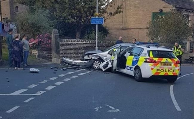 Queensbury, Cockin Lane crash with police car sees man arrested