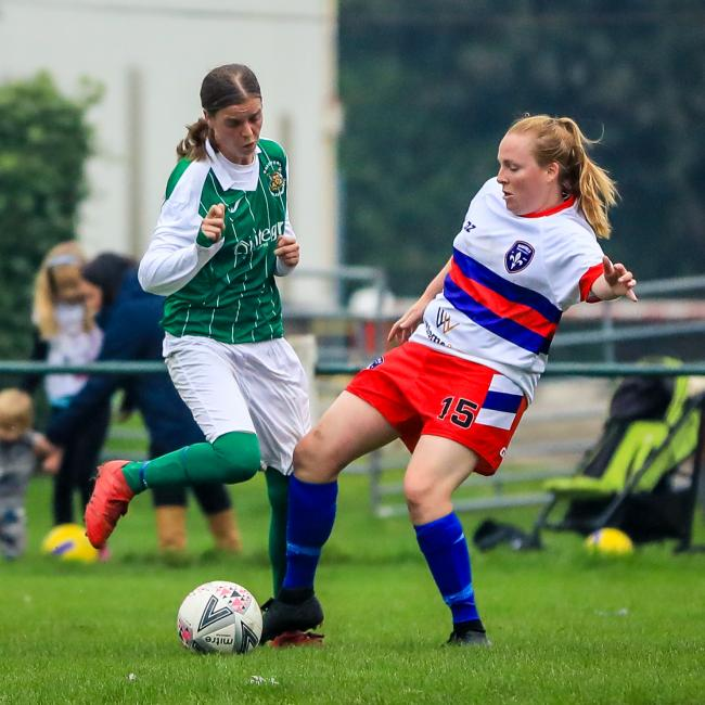 Millie West (green) scored a fine goal for Bradford (Park Avenue) Ladies against Wakefield Trinity but her team still slipped to a heavy defeat Picture: Steve Biltcliffe Photography